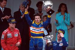 Podium: race winner Olivier Panis, Ligier, second place David Coulthard, McLaren, third place Johnny Herbert, Sauber