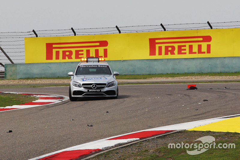 The FIA Medical Car passes debris on the circuit