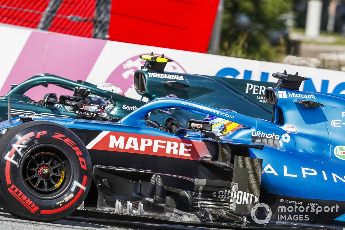 Fernando Alonso, Alpine A521, alongside Sebastian Vettel, Aston Martin AMR21