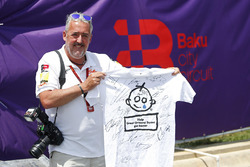 Mark Sutton, F1 Photographer with a signed Great Ormond Street T-shirt