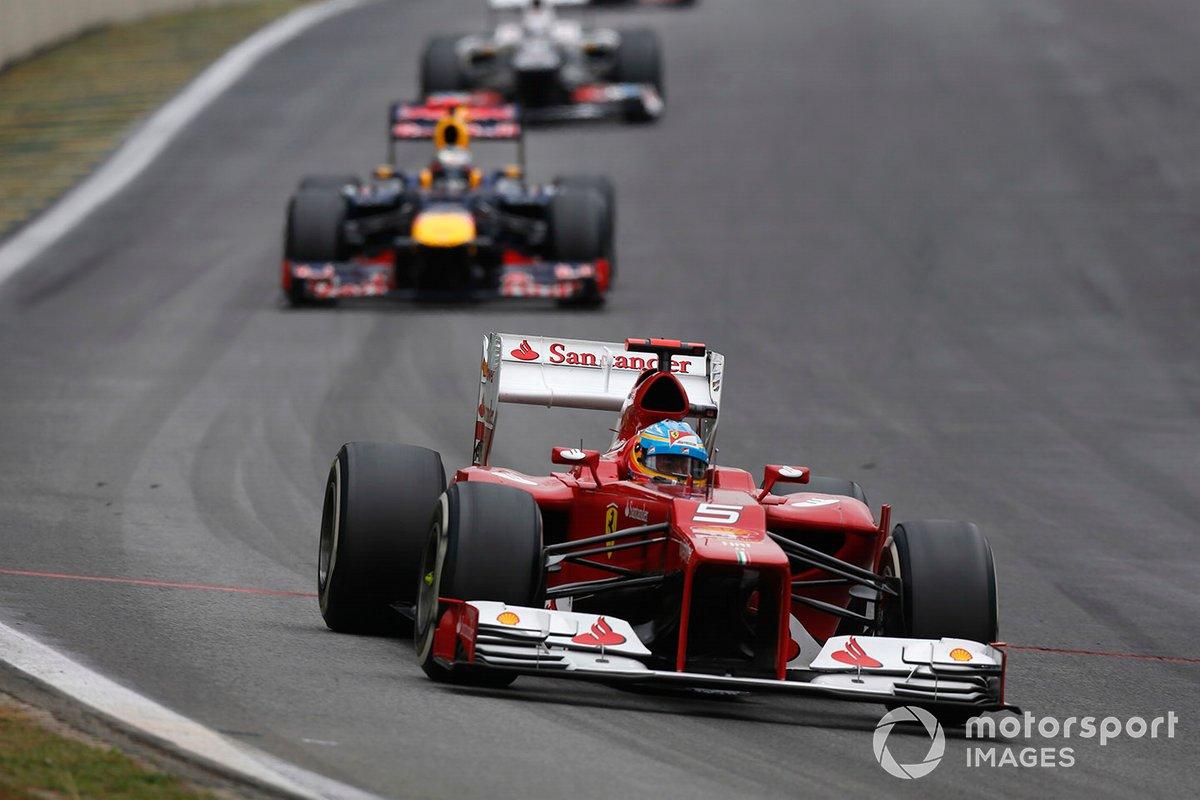Fernando Alonso, Ferrari F2012, leads Sebastian Vettel, Red Bull RB8 Renault