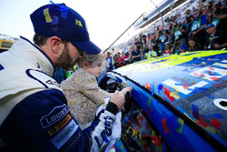 Race winner Jimmie Johnson, Hendrick Motorsports Chevrolet and his daughter, Lydia, affix the winner's decal on his car