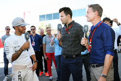 (L to R): Lewis Hamilton, Mercedes AMG F1 with Steve Jones, Channel 4 F1 Presenter and David Coulthard, Red Bull Racing and Scuderia Toro Advisor / Channel 4 F1 Commentator