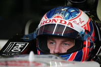 Button takes over at Barcelona