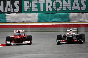 Perez hands Sauber podium in wild, wet Malaysian GP