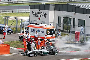 Hamilton's car catches fire in Q1 - video