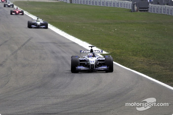Juan Pablo Montoya in front of Ralf Schumacher