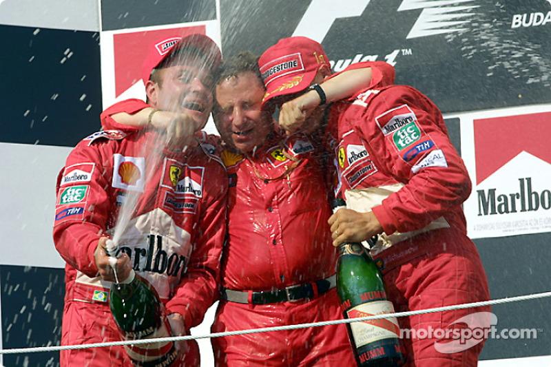Rubens Barrichello, Jean Todt and Michael Schumacher celebrating
