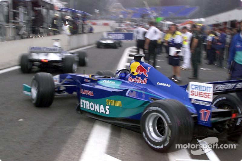 Kimi Raikkonen leaving the pit