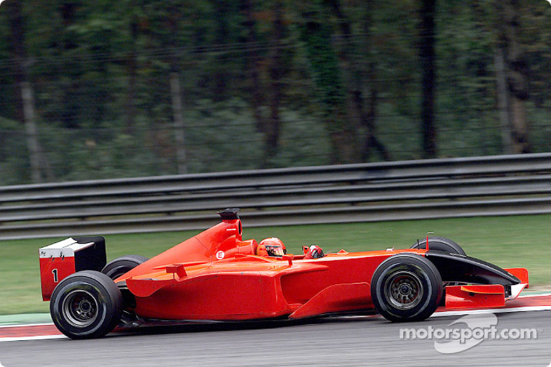 Michael Schumacher driving the Ferrari with no sponsor and a black nose