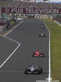 Juan Pablo Montoya in front of Rubens Barrichello