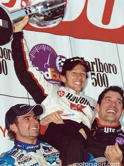 The podium: race winner Cristiano da Matta with Alex Tagliani and Max Papis