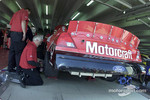 Woods Brothers crew members working on the Motorcraft Ford Taurus of Elliott Sadler
