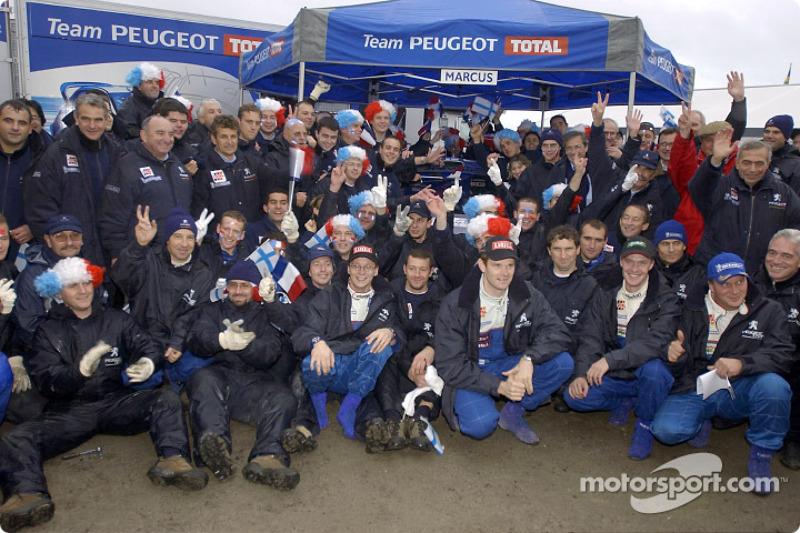 Team Peugeot celebrating
