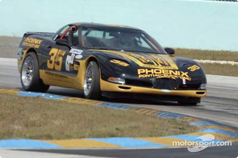 The #35 Phoenix American Motorsports Corvette takes a tight curve