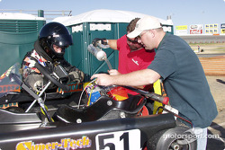 Crewmember Terry Jester fuels the #51 kart while fellow crewmember and engine builder Rick ëHuffyí Huffman and driver Jace Reynolds make last minute checks on their new motor