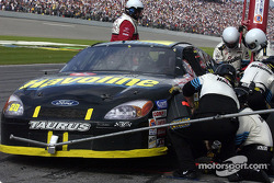 The 2002 NASCAR season will see all crew members and NASCAR officials who go over the pit wall wear crash helmets; here the Texaco crew of Ricky Rudd try out the new heaswear as Rudd pits