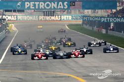 The start: Michael Schumacher, Juan Pablo Montoya and Rubens Barrichello leading the field