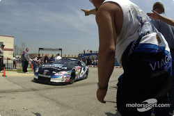 Mark Martin in his Viagra Ford motoring by an enthusuiastic fan on his way to practice