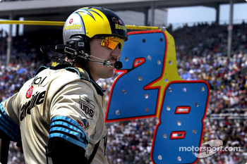 A crewman for Ricky Rudd waits and watches his driver work his way through traffic