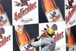 The podium: champagne for Jean Alesi