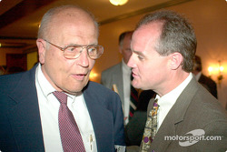 The Honorable John Dingell and Kenny Wallace exchange racing stories