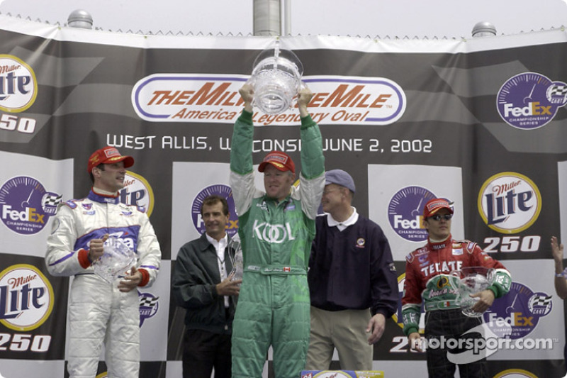 The podium: race winner Paul Tracy, with Adrian Fernandez and Max Papis