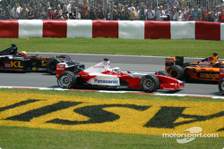 First corner: Allan McNish and Mark Webber