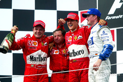 The podium: race winner Rubens Barrichello with Jean Todt, Michael Schumacher and Ralf Schumacher