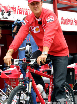 Michael Schumacher on a bicycle for a lap around the track