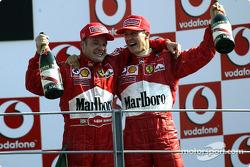 The podium: race winner Rubens Barrichello with Michael Schumacher