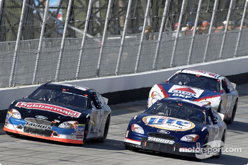 Kurt Busch battles with Rusty Wallace and Jeff Burton