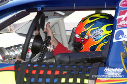 Jeff Gordon adjusts the steering wheel
