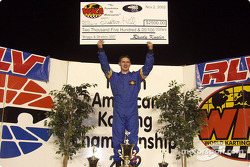 Briggs & Stratton 300 winner Justin Hill on the podium with his check