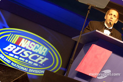 Greg Biffle on stage making his acceptance speech during the banquet
