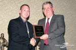Ted Yerzyk accepts an appreciation award from Ernie Saxton (EMPA's president) for the support NHRA has provided to EMPA over its long history