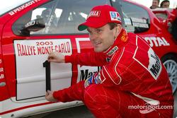 Marcus Gronholm sticks his World Championship #1 on his Peugeot