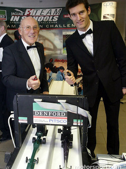 Sir Stirling Moss challenges Jaguar F1 driver Mark Webber to a race at the launch of the NSPCC Coventry Campaign