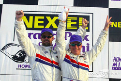 The podium: Daytona Prototype and overall winners J.C. France and Hurley Haywood