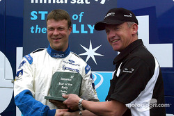 Nicky Grist presents Stéphane Prévot, François Duval's co-driver with the Inmarsat Star of the Rally