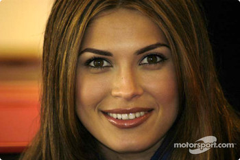 Miss Universe, Justine Pasek, took a 120 mph lap around Road Atlanta Saturday during a break from her visit to Braselton for a photo shoot for the June 2003 premier issue of Atlanta-based Exquisite Brides & Weddings magazine