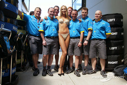 Wonder Bra model Marina Dior with a Renault F1 team member
