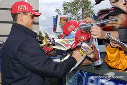 Michael Schumacher signs autographs