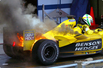 Giancarlo Fisichella getting out of the Jordan on fire in the parc fermé