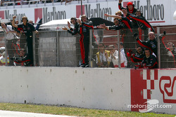 Minardi team members celebrate finishes by Justin Wilson and Jos Verstappen