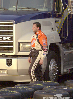 Tony Stewart takes a path through the tires to get back to his hauler