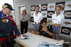 A fan presents Alex Zanardi with his trademark pineapple