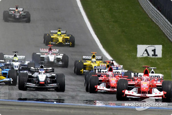 First corner: Michael Schumacher leads the field