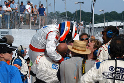 Race winner Johnny Herbert celebrates