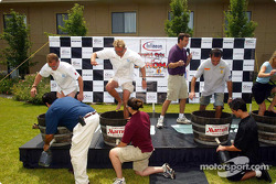 American Le Mans Series drivers Johnny Herbert, J.J. Lehto and Eliseo Salazar participate in a grape stomp competition on Wednesday in Napa; Herbert won the contest by producing the most juice while stomping the grapes